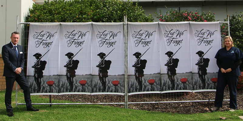 CEO, Mr Tim Griffiths and Director of Clinical Services, Rebecca Weir in front of the ANZAC Commemorative banner at NHW.