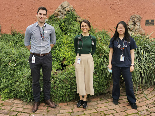 Three new Junior Medical Officers stood in the spiritual gardens at NHW
