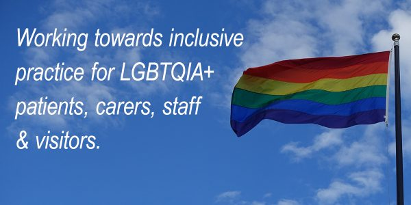 LGBTQIA+ rainbow coloured flag flying with blue sky background and the words Working towards inclusive practice for LGBTQIA+ patients, carers, staff & visitors.