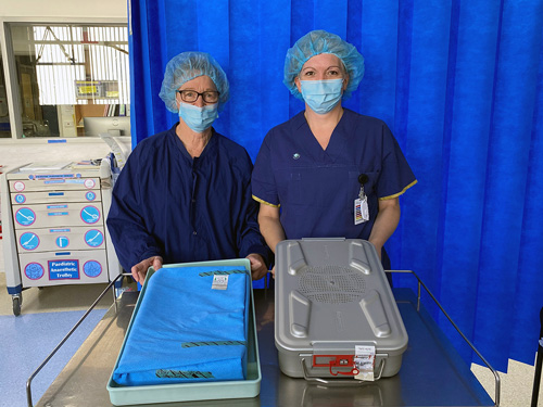 Peri-Operative Services Manager Lois Foley and Central Sterilising Supply Department Manager Carolyn Hannon showing the sterilisation wrap (to the left) and the new metal sterilisation canisters (to the right)