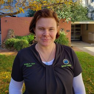 Tracey McGeehan profile picture taken in the spiritual sanctuary garden at NHW