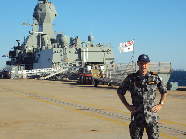 CEO, Tim Griffiths stood in front of an Australian battle ship on active duty with the Royal Australian Navy