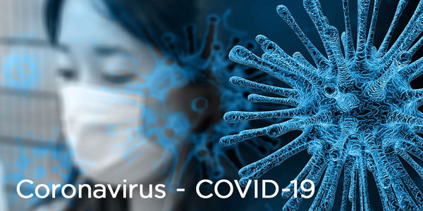 Girl wearing a mask with abstract cells representing the coronavirus