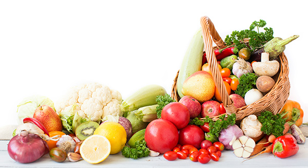Fresh vegetables and fruit in basket on white background