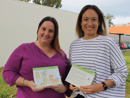two young ladies from the health promotions team holding the new resources for pregnant women