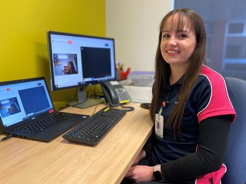 Young female speech pathologist using video calls for paediatric Speech Pathology consultations.